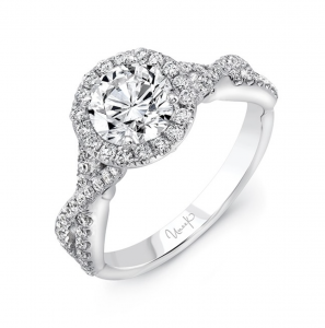 Halo style engagement ring with twisted shank