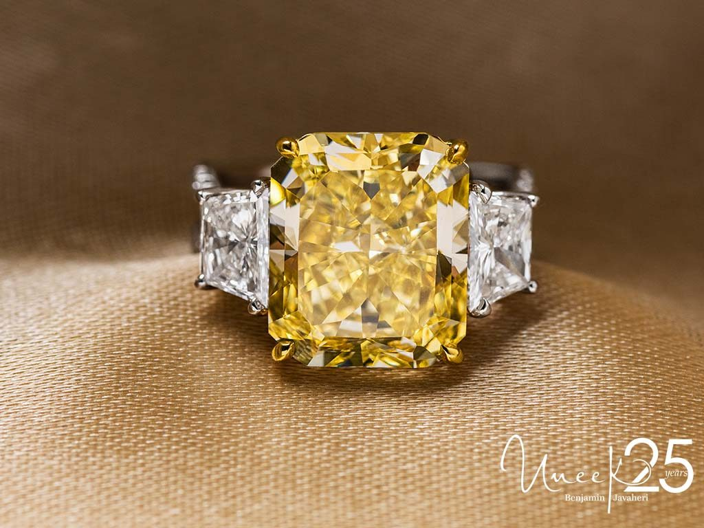 LVS1016RADFY - Celebrate the ultimate personalized luxury with a fancy yellow diamond flanked by impressive side stones.