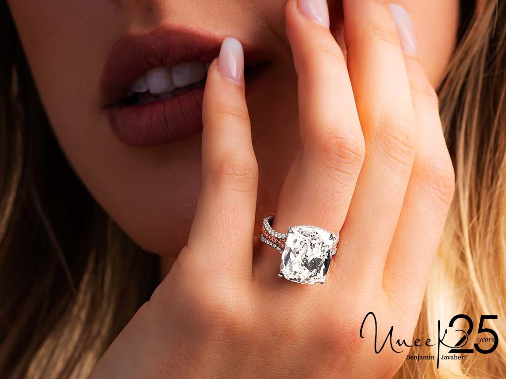 LVS1066 - You'll swoon over this bold cushion cut nested on a triple band with pink diamonds.